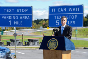 """It can wait!"" Governor Cuomo unveiled ""Text Stop"" signage in 2013 to encourage drivers to wait before using their phones. Photo provided by NYS Governor's Press Office."