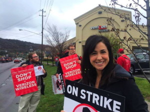 Striking union workers and supporters outside Ithaca's Verizon Wireless store. Photo courtesy TCWC.