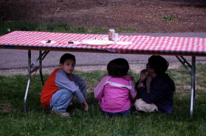 Kids take cover from the rain at Cornell's alumni reunion. 14850 Photo.