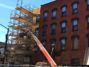 New brick being laid by hand on the Griffin Block building in Downtown Ithaca. 14850 Photo.