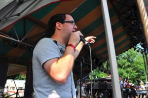 Chris Wilson emceeing the Infield Stage at the GrassRoots Festival. 14850 Photo.