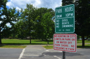 """""""No firearms in park,"""" says a sign at Stewart Park. 14850 Photo."""