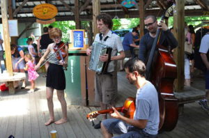 Live music at the Ithaca Farmers Market at Steamboat Landing. 14850 file photo.