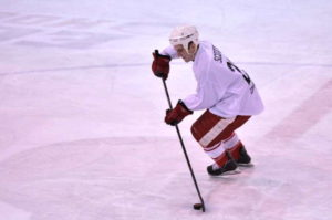 Cornell alum Topher Scott playing at an alumni charity game for the Racker Centers. 14850 file photo.