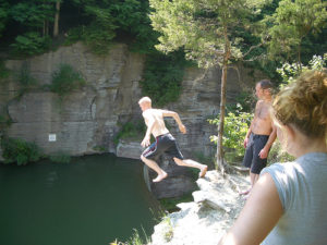 Swimmers jumping off a bunker into the reservoir above Second Dam. 14850 file photo.