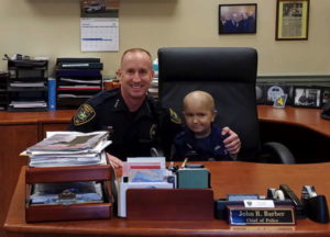 Honorary officer Colin Toland in IPD police chief John R. Barber's office. Photo courtesy of Toland family.