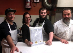 The Lincoln Street Diner crew posing with proclamation and key to the city. 14850 file photo.
