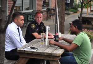 Mayor Svante Myrick (left) and IPD Chief John R. Barber met with area residents in a Coffee with the Chief series last year. 14850 file photo.