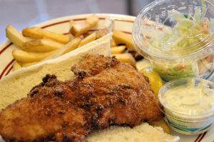 "Fried haddock special with fries and ""coal"" slaw."
