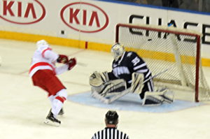 Cornell junior Alex Rauter beats UNH's Danny Tirone glove side for a 3-1 lead. 14850 photo by Mark H. Anbinder.