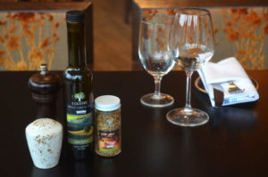 Extra virgin olive oil and spice blends specially packaged for Monks by F. Olivers.
