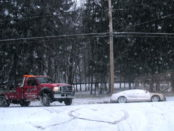 Snowy roads with tow truck