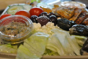 Greek Salad and stuffed grape leaves.